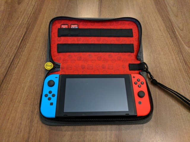 PDP Mario Switch Case with Nintendo Switch system and games