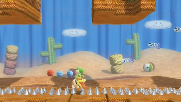 Yoshi riding Poochy in Yoshi's Woolly World for Wii U